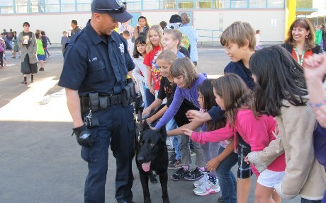 Police officer and patrol dog with students
