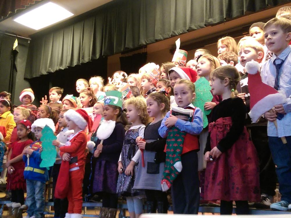 Mrs. Kolodzie & Mrs. Robinson prepare Kindergarten students for the 2015  Holiday Concert.