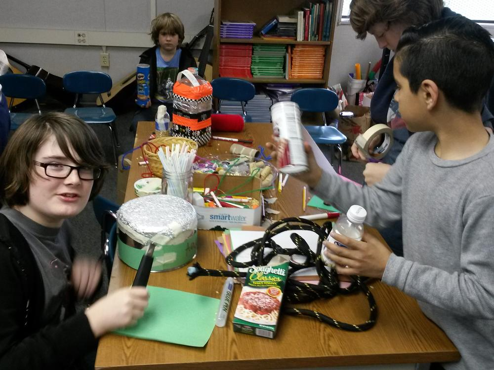 5th Grade students getting creative making musical instruments from recycled  materials.